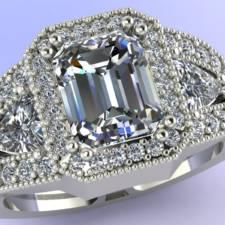 Custom three stone Emerald and trillion diamond ring